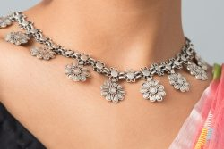 Silver necklace floral motif