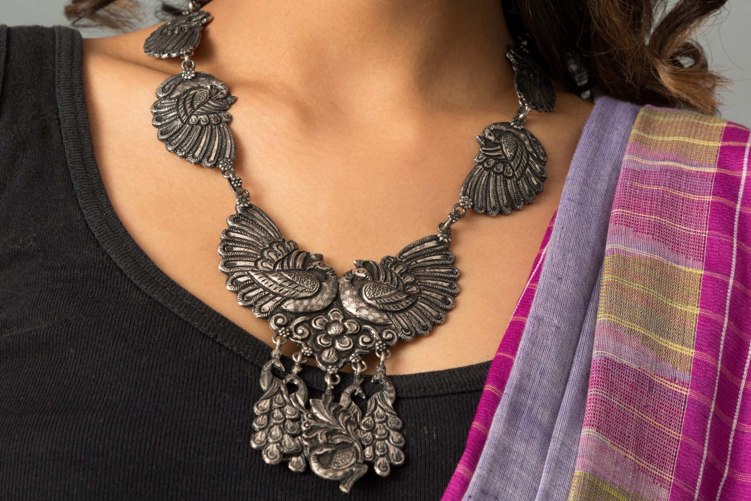 Silver necklace peacock motif